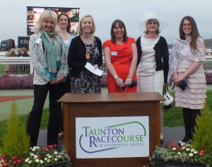 Partner Lesley Gaskell and Solicitor Elizabeth York with guests at the winners podium