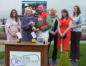 Partner Lesley Gaskell makes presentation to winning jockey